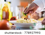 close up on the hand of a chef... | Shutterstock . vector #778927993