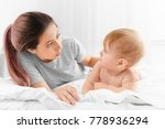 young mother and her cute baby... | Shutterstock . vector #778936294