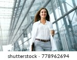 beautiful woman going to work... | Shutterstock . vector #778962694