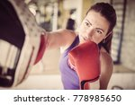 woman boxer hitting the glove... | Shutterstock . vector #778985650