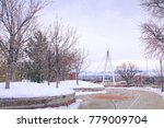Small photo of City: Pedestrian Point of View at Legacy Bridge in University of Utah. Walking from Dormitory to Campus. Snowing and Leafless Trees the in Afternoon. Bicycle is Allowed.