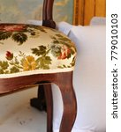 Small photo of Detail of a freshly upholstered antique chair in the upholsterer's workshop