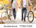 young couple walking with... | Shutterstock . vector #779017309