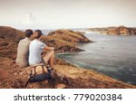 couple tourists with backpacks... | Shutterstock . vector #779020384