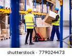 young workers in a warehouse.   Shutterstock . vector #779024473