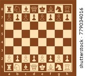 wood chess board with chess... | Shutterstock .eps vector #779034016