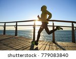 sporty fitness female runner... | Shutterstock . vector #779083840