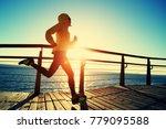 sporty fitness female runner... | Shutterstock . vector #779095588