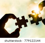 two hands trying to connect... | Shutterstock . vector #779122144