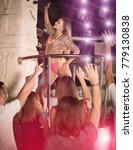 Small photo of Cheerful woman dancer gogo dancing in the night club on stage