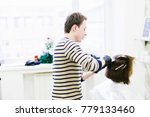 the hairdresser in the beauty... | Shutterstock . vector #779133460