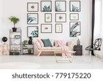 gold table near designer stool...   Shutterstock . vector #779175220