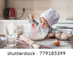 happy little kid in chef hat... | Shutterstock . vector #779185399
