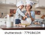 mother teaching her adorable... | Shutterstock . vector #779186134