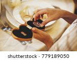bride takes a coin with a... | Shutterstock . vector #779189050