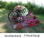 Flowers With A Wooden Wheel
