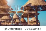 two wineglasses of white wine . ... | Shutterstock . vector #779210464