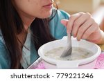 female patients are eating... | Shutterstock . vector #779221246