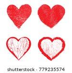 set of grunge hearts.vector... | Shutterstock .eps vector #779235574
