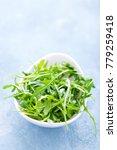 fresh arugula leaves in bowl on ...   Shutterstock . vector #779259418