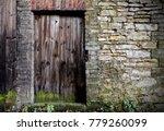 old wooden door in stone wall | Shutterstock . vector #779260099