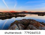 the sky and rocky edge reflects ... | Shutterstock . vector #779266513