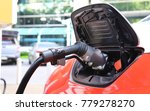 electric car is charging at the ... | Shutterstock . vector #779278270