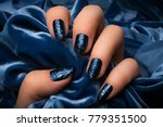 the female hand with dark blue... | Shutterstock . vector #779351500