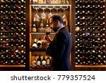 handsome mature man tasting... | Shutterstock . vector #779357524