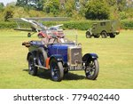 Small photo of Old Warden Airfield, Bedfordshire / UK - 08/07/16: 1926 Jowett Class C at the Shuttleworth Collection, with Hawker Demon, Hillman Minx and Fordson WOT 2H in background.