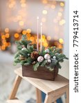 Small photo of ablaze candles. Workshop of Christmas decor with their own hands. Christmas wooden box with fir branches for the holiday. The new year celebration.