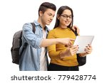 teenage students looking at a... | Shutterstock . vector #779428774