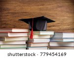 studant het and stack book | Shutterstock . vector #779454169