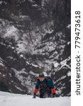 Small photo of winter mountain alpinist climbing
