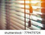 wooden blinds with sun light.... | Shutterstock . vector #779475724