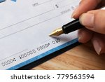 Small photo of Writing signing a check
