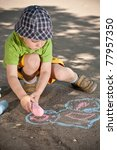 boy drawing with chalk on... | Shutterstock . vector #77957350