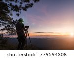 hiker with camera on tripod... | Shutterstock . vector #779594308