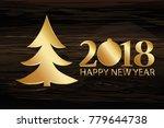 christmas tree with golden... | Shutterstock .eps vector #779644738