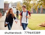 teenage students walking around ... | Shutterstock . vector #779645389