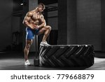 muscular man working out in gym ... | Shutterstock . vector #779668879