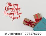 two gifts with red ribbons and... | Shutterstock . vector #779676310