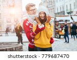 hipster couple in knitted... | Shutterstock . vector #779687470