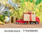 miniature red trucks help carry ... | Shutterstock . vector #779698090