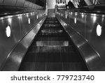 escalator going down with... | Shutterstock . vector #779723740