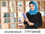 muslim woman with notebooks | Shutterstock . vector #779728408