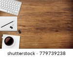 papers with pen and keyboard on ... | Shutterstock . vector #779739238