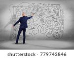 view of a businessman drawing a ... | Shutterstock . vector #779743846