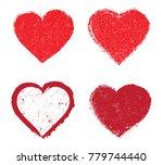 set of grunge hearts.vector... | Shutterstock .eps vector #779744440