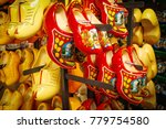 Small photo of Dutch wooden shoes in the souvenir shop. Red and yellow Clog and Klomp in the storefront. Wooden klompen.